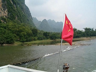 the red flag is waving on a river cruise boat from Guilin to Yangshuo