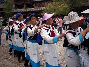 women are dancing on sifang square in Lijiang, China